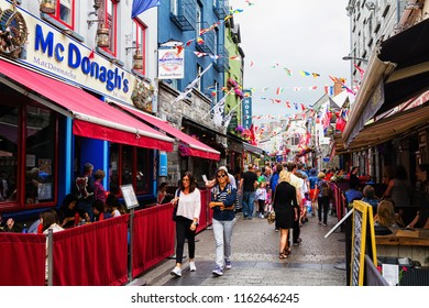 GALWAY, IRELAND - JULY 11, 2018: Street scene in historic Galway. This medieval coastal city is now a lively cultural center and popular tourist destination.