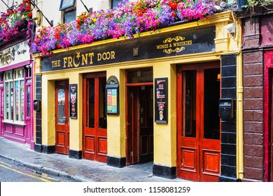 GALWAY, IRELAND - JULY 12, 2018: Front view of an old colorful facade of the building. Old restaurant and pub in the city centre of Galway, Ireland.