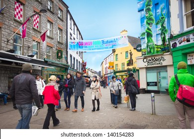 GALWAY, IRELAND - MAR 31: Street scene in historic Galway City Ireland on Mar 31, 2013. This medieval coastal city is now a lively cultural center and popular tourist destination.