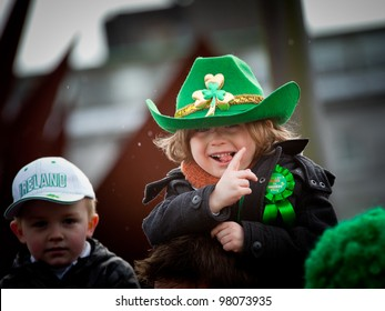 GALWAY, IRELAND - MARCH 17: Unidentified Kids enjoy watching the annual traditional St. Patrick's Day Parade on March 17, 2012 in Galway, Ireland.