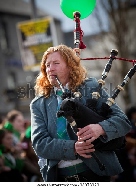 GALWAY, IRELAND - MARCH 17: Unidentified  Bagpipes musician performs at the annual traditional St. Patrick's Day Parade on March 17, 2012 in Galway, Ireland.