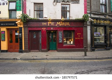 GALWAY, IRELAND - MARCH 31, 2013: Street scene with quaint old shops in Galway, Ireland.  This historic city dates back to the 1100's.