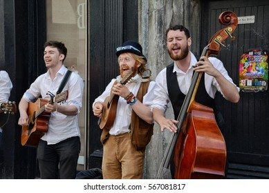 GALWAY, IRELAND - MAY 2016: Buskers performing music on the streets of Galway