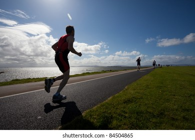 GALWAY, IRELAND - SEPT 4: Unidentified athletes compete at first Edition of Galway Iron Man Triathlon on September 4, 2011 in Galway, Ireland