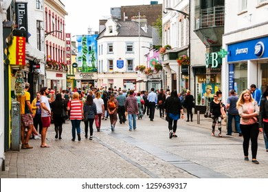 GALWAY, IRELAND - September 11, 2014: The busy downtown in Galway, Ireland, on a sunny summer day, with colorful buildings and people passing by.