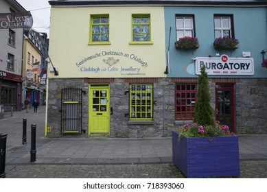 GALWAY, IRELAND - SEPTEMBER 19, 2017: Colorful facades of shops in the heart of Galway.