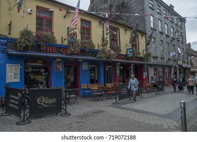GALWAY, IRELAND - SEPTEMBER 19, 2017: Typical day on the Quay street , the most popular street in the city centre.