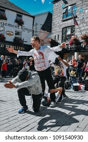 Galway, Ireland - September 3 2016: Street performers performing a modern dance routine among crowds.