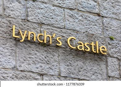 Galway, Republic of Ireland - August 19th 2018: The sign on the exterior of the historic Lynch's Castle in the city of Galway, Republic of Ireland.
