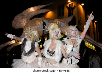 """GALWAY-MARCH 14: actress Triona Lillis, Debbie Wright, Orla De Bhaldraithe in acts of Macnas """"THe Hare"""" on streets of Galway, part of St.Patric Day, March 14, 2010 in Galway, Ireland"""