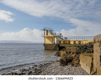 Galwy city, Salthil, Galway landmark, Blackrock diving tower, sunny day, clouds, nobody.