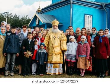 Galyna Volia, Volyn / Ukraine - October 09 2009: Metropolitan Volyn Lutsk and Ukrainian Orthodox Church Metropolitan Nifont with parishioners next to the church