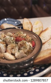 gambas al ajillo, shrimps and bread macro photo