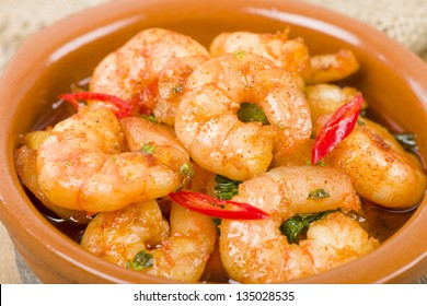 Gambas Pil Pil (Sizzling prawns with chili and garlic). Traditional Spanish tapas dish.