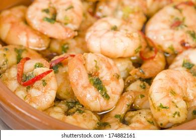 Gambas Pil Pil - Sizzling prawns with chili and garlic. Traditional Spanish tapas dish.