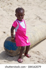 GAMBIA - FEBRUARY 23: Unidentified African child playing on the beach, February 23, 2014 in TANJI, GAMBIA.