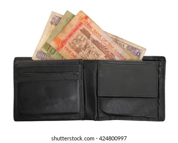 Gambian dalasi bank notes in a leather wallet, selective focus