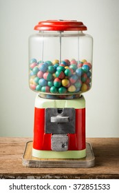 gamble eggs in vintage coin operated gumball machine on old wood