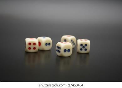 Gambler five dices, luck metaphor over black background