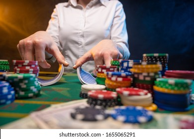 Gambling business in a casino. Industry in night clubs, croupiers or dealers, distribution of cards. A lot of money, chips. Online poker business.