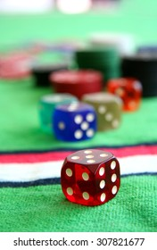 Gambling chips and dices in casino