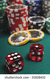 gambling chips and dices on green background