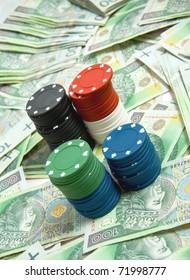 Gambling chips on money background. Polish Zloty