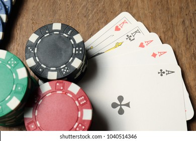 gambling, fortune, game and entertainment concept. Ful House on a wooden table with poker chips