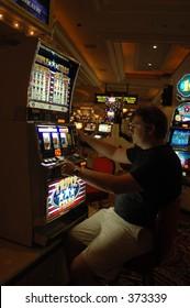Gambling in Las Vegas casino at slot machine