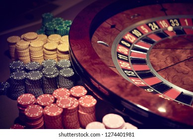 Gambling roulette with chips in the casino