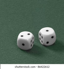 gambling theme with two dice on green felt