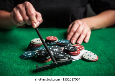 Gambling.Close-up cards for playing poker on a gaming table in a casino against a background of chips. Background for a gaming business