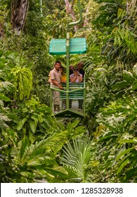 GAMBOA, PANAMA - AUGUST 15, 2009: Tourists and guide in aerial tram teleferico in jungle at Gamboa Rainforest Resort.