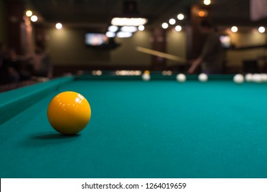 The game of American and Russian billiards. Pool table, ball and cue. Sports leisure. Friendly tournament. Winter fun. Green cloth in billiards. Luza for the ball. Aim and beat. Cue kick.