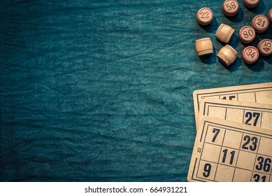The game of bingo consists of cards and barrels with numbers on a green background, the game russian lotto with copy space