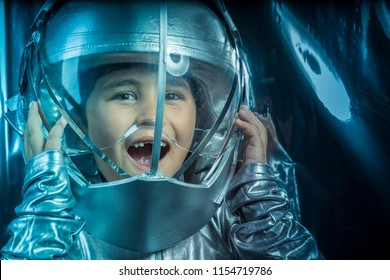Game, Boy playing to be an astronaut with space helmet and metal suit