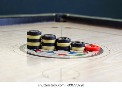 A game of carrom with pieces carrom man on the board carom - stacking