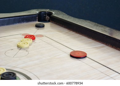 A game of carrom with pieces carrom man on the board carom -