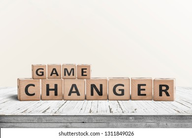 Game changer sign made of wooden blocks on a desk in a bright room