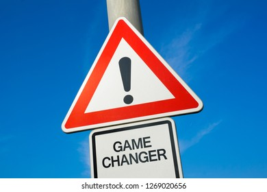 Game changer - traffic sign with exclamation mark to alert, warn caution - revolutionary and visionary innovation leading to progress and advanced turning point and transformation