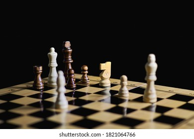 Game of chess. Sacrifice of a strong figure, for the sake of a common victory
