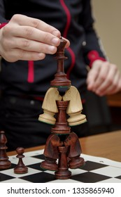 Game of chess. Wooden chess pieces with a chessboard