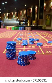 Game chesspieces on a table of roulette