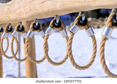 game for children made of wood and rope. playground in winter. Close up. Macro photograpy