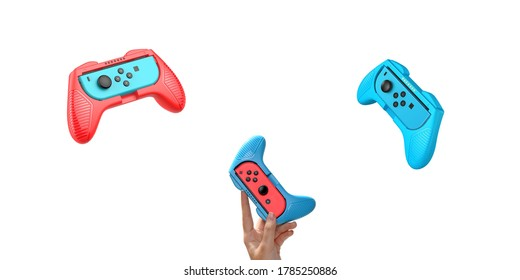 Game console on hand isolated white background. Red Blue Gaming console. Wireless game controller
