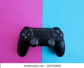 game controller black on colored paper