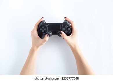 Game controller of gaming consoles in woman hands