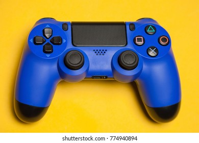 game controller over yellow background