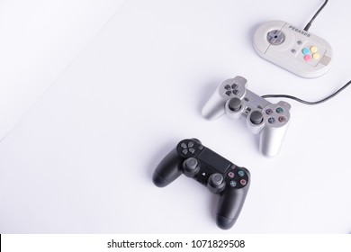 game controllers playstation 1, 2 and pegasus  from older to newer on a white background