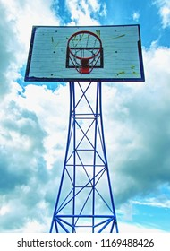 The game could begin. Basketball hoop  above outdoor playground  with sky in the background